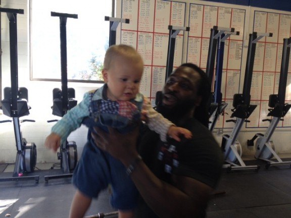 Kendrick's done lifting weights...from now on he's lifting babies exclusively. Bode doesn't seem to mind one bit.