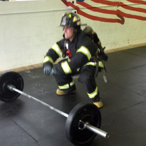 "Mike Burnes doing ""Hotshots 19"" in full firefighting gear."